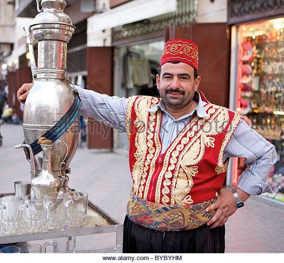 Portrait of traditional street tea seller, Aleppo, Syria - Stock Image