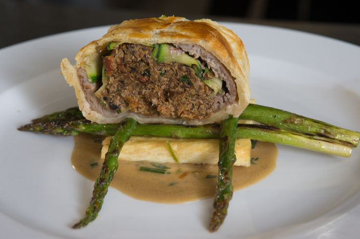 Mushroom & Steak Wellington Over Cassava & Grilled Asparagus with a Wild Mushroom Sauce.
