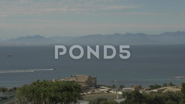 4k Speed Boats On Beautiful Blue Water Ocean Mountains In Background - Stock Footage   by RyanJonesFilms