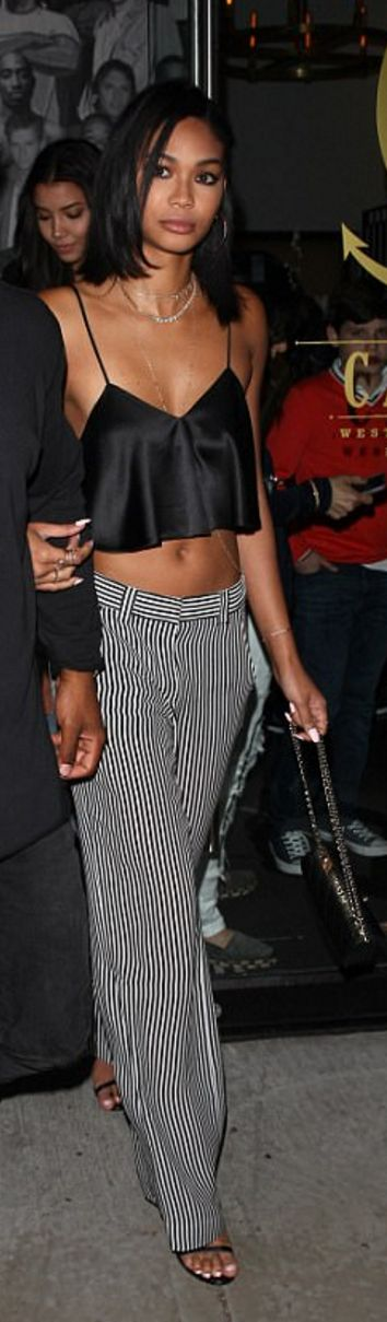 Who made Chanel Iman's black satin crop top?