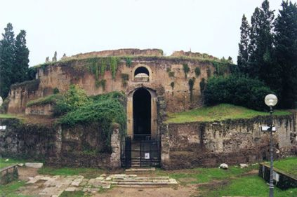 This would be the front of the Mausoleum of Augustus. They began reconstruction of this and began by guessing how it would have been back then.   http://www.raceandhistory.com/Europe/mausoleum.html  http://www.livius.org/ro-rz/rome/rome_mausoleum_augustus.html