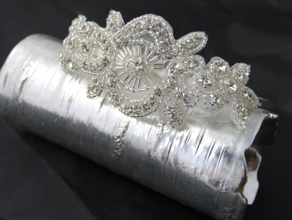 A vintage feel to this one...  Lace inspired, this side design headpiece is elegantly beautiful. A variety of beads and rhinestone crystals