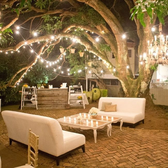 Keep the party in your back yard well-lit by hanging and wrapping strings of lights to trees around your dining space! #BackyardLighting #eventprofs