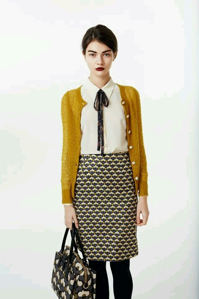 .  |  I like the pencil skirt and the mustard cardigan.