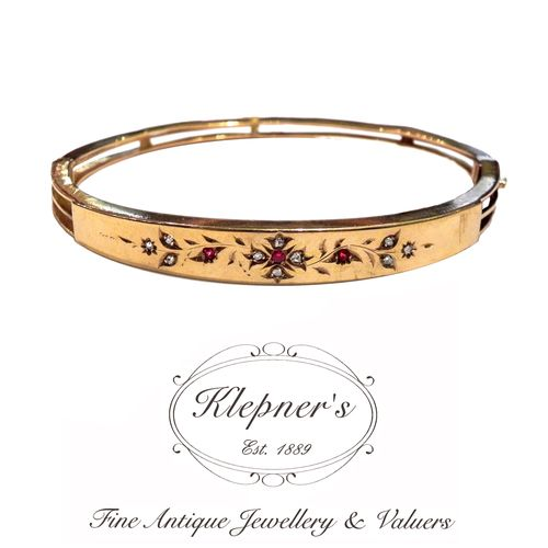 15ct yellow gold antique Edwardian ruby & diamond floral hinged bangle. Visit us at www.klepners.com.au