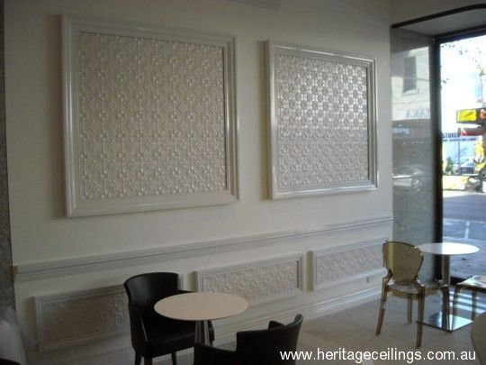 Original pressed tin panels framed on walls. The panels add a lift to what otherwise could be a somewhat boring wall. For more pressed tin designs see: http://www.heritageceilings.com.au/tin-ceilings-patterns.php