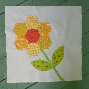 The Quickie Hexie Flower Quilt Block is a simply precious way of adding English paper piecing patterns to your next flower quilt pattern.