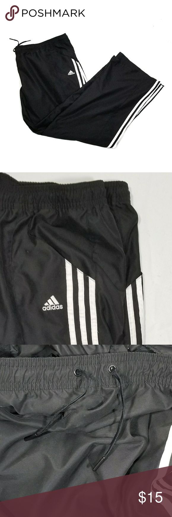 Mens Adidas Black & White Athletic Pants- Size 2XL Mens Adidas black athletic pants. Has white stripes on the sides,  pockets, zip up adjustable bottoms and tie waistband.  Size 2XL adidas Pants
