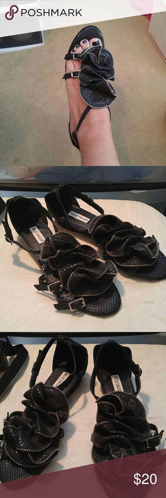 Kelsi Dagger Black Reptile Print Ruffled Sandals 9 Kelsi Dagger Black Reptile Print Ruffled Sandals. Size 9. Preowned but in great shape! Kelsi Dagger Shoes Sandals