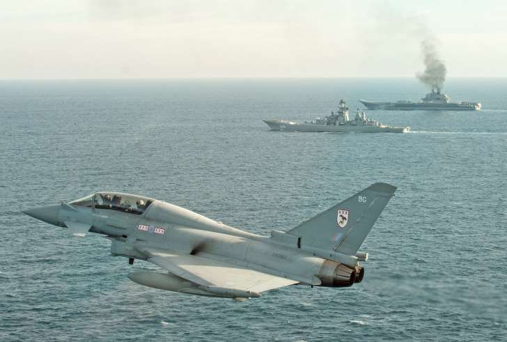 RAF Typhoons with the Russian Warships Petr Velikiy and Admiral Kuznetsov earlier this year (MoD/PA)
