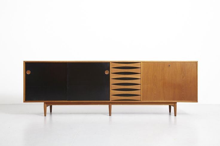 Sold Large teak sideboard with 2 reversible sliding doors (black or teak), 7 drawers and 1 pull-out. Fully veneered back, can be used as a room…