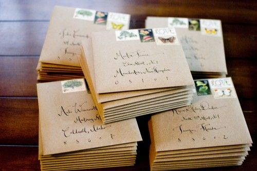 vintage postage, brown/natural envelopes, gorgeous calligraphy (love the playfully spaced out zip code!)
