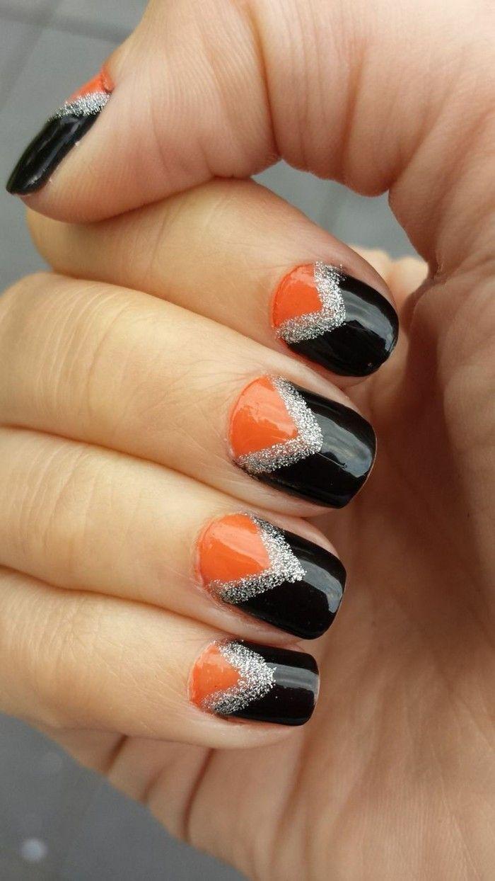 halloween nägel maniküre in orange und schwarz