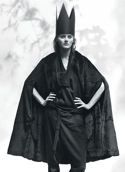 Ann Demeulemeester's black weasel fur and leather cape and black wool, linen…