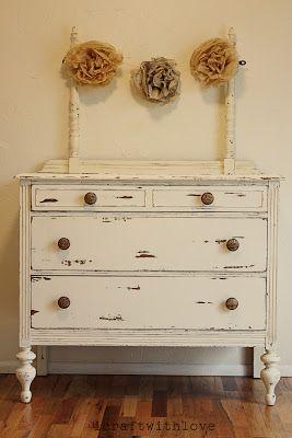 Vintage Distressed White Dresser With Vintage Flower Decorations