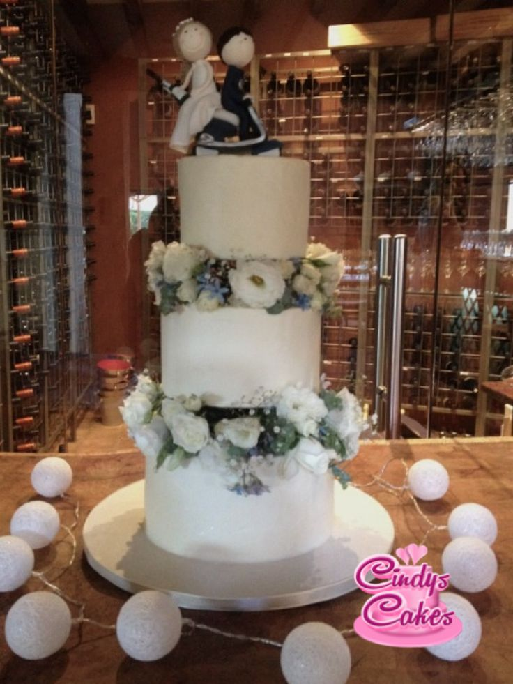 Wedding cake with beautiful flowers between the tiers