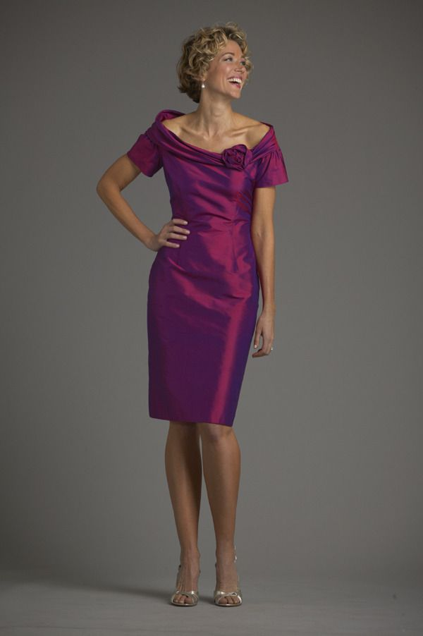 Mother of the Bride? Off the shoulder collar with flower detail and short sleeves over straight skirt. Shown in shantung.