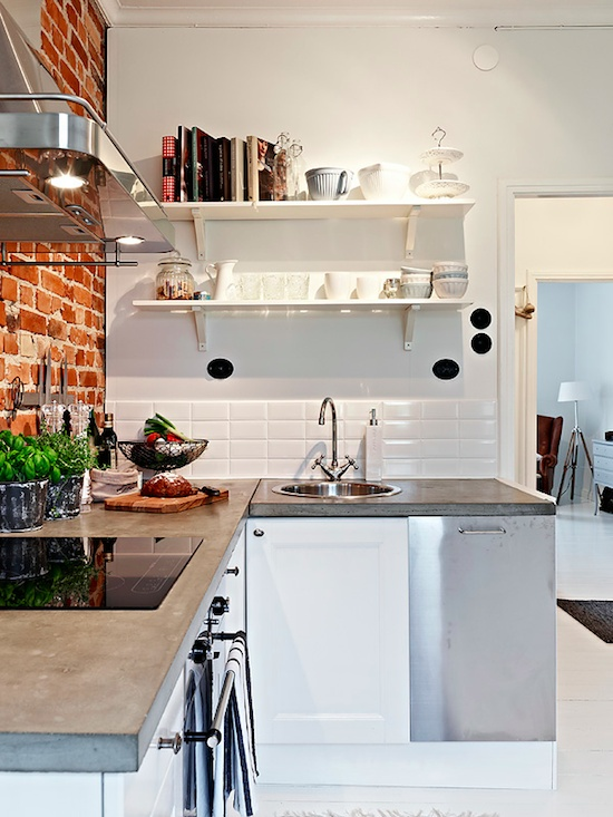 Love the poured concrete bench top and exposed brick