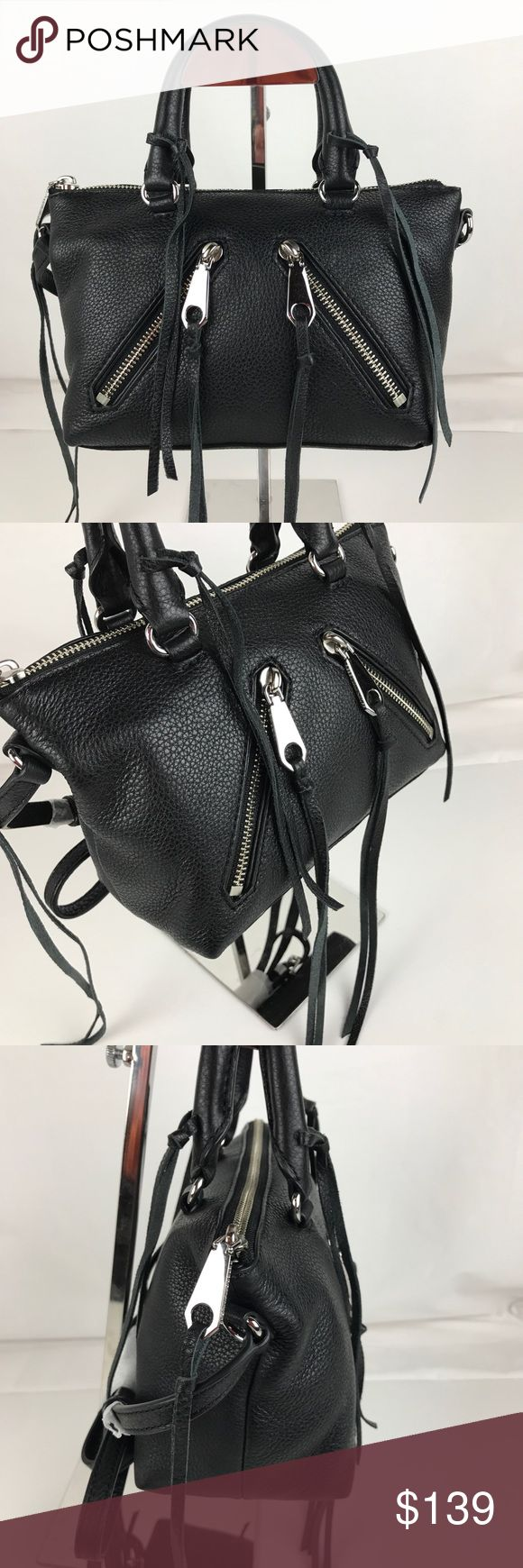 """Rebecca Minkoff Micro Moto Black Leather Satchel Authentic Rebecca Minkoff Style HS16EMOX26. New without Tag. Includes Original Dust Bag.  Super Cute! Double zip exterior pockets, inside pockets, rolled top handles and a crossbody strap provide street-chic carrying options. 10""""W x 4""""D x 6""""H; 3.5"""" handle drop, 25"""" strap drop. Style HC35EMOX26. RB531-2  Enjoy fast shipping and epic customer service from a trusted 5-star Poshmark Ambassador with over 1000 handbags sold to date! Rebecca Minkoff…"""