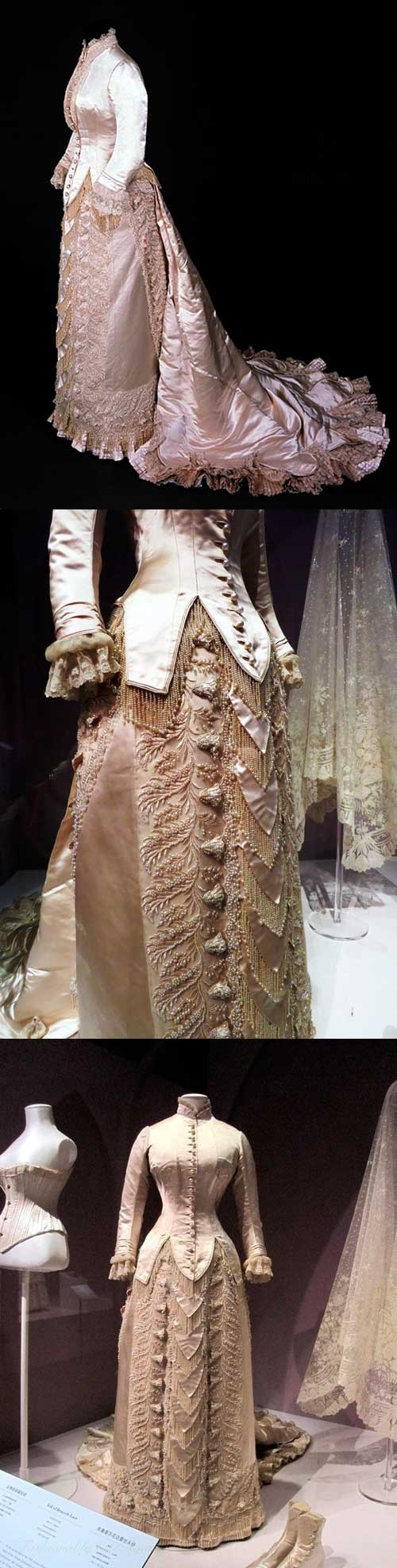 Wedding dress by Charles Frederick Worth, 1880. Bodice made of cream silk satin, fastened with pearls. Neck and center front opening trimmed with machine-made lace. Lined with white silk and braid. Skirt of cream silk satin. Front and hips trimmed with panel of embroidery on net with pearls and satin stitch in design of leaves and stiffened bell-shaped flowers. Overlapping lobes of satin trimmed with pearl fringe in the center. Train of cut and uncut velvet. #wedding #worth