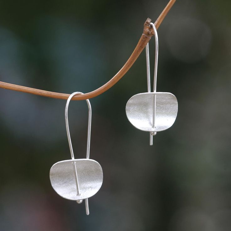The modern, minimalist design of these earrings is by Desi Antari in Bali. She crafts the sterling silver earrings by hand and finishes them with brushed satin textures.