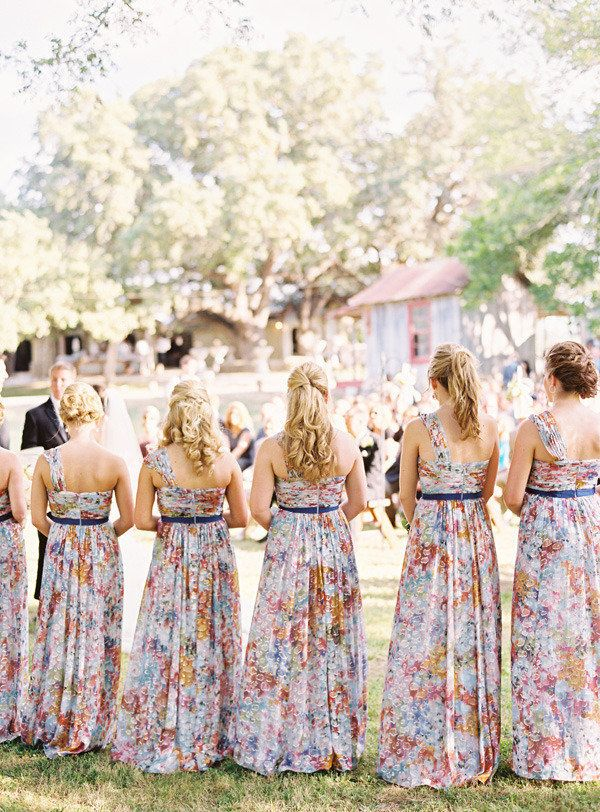 Love these printed dresses!! Photography by ryanrayphoto.com, Floral   Event Design by razzledazzlejone.wix.com/rd100, Wedding Coordination by planningonefineday.com