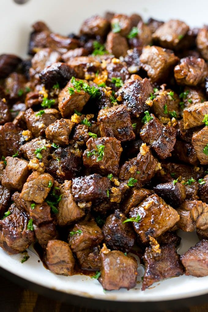 These seared steak bites are cubes of sirloin steak cooked to perfection in a garlic butter sauce. An easy meal or party snack that's ready in just minutes! If you've got meat lovers in your life, you HAVE to try these garlic butter steak bites.