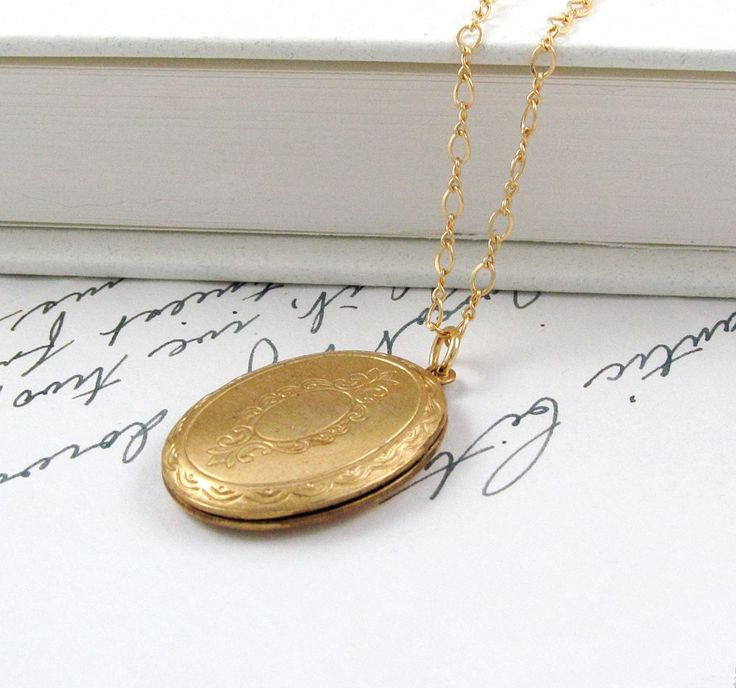 Vintage brass gold locket necklace with Victorian motif on gold filled chain. Fabulous art deco every day locket necklace, simple and elegant. The perfect keeps