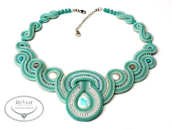 """Necklace made with Soutache embroidery technique. Amazonit and seashell perl, surrounded on braid cord and fire polish. Back glued with delicate suede in matching color. Metallic finish in silver color. Impregnated which significantly reduces the absorption of dirt . Height soutache motif in the central part is 7 cm (2,75""""). Circumference around the neck 44 cm (17,2"""") plus 5 cm chain."""