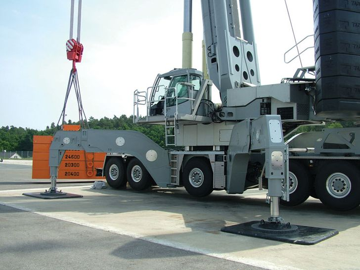 Tadano ATF 600G-8 Triple Boom with X-pattern outriggers lifting a test load in Germany June 2015