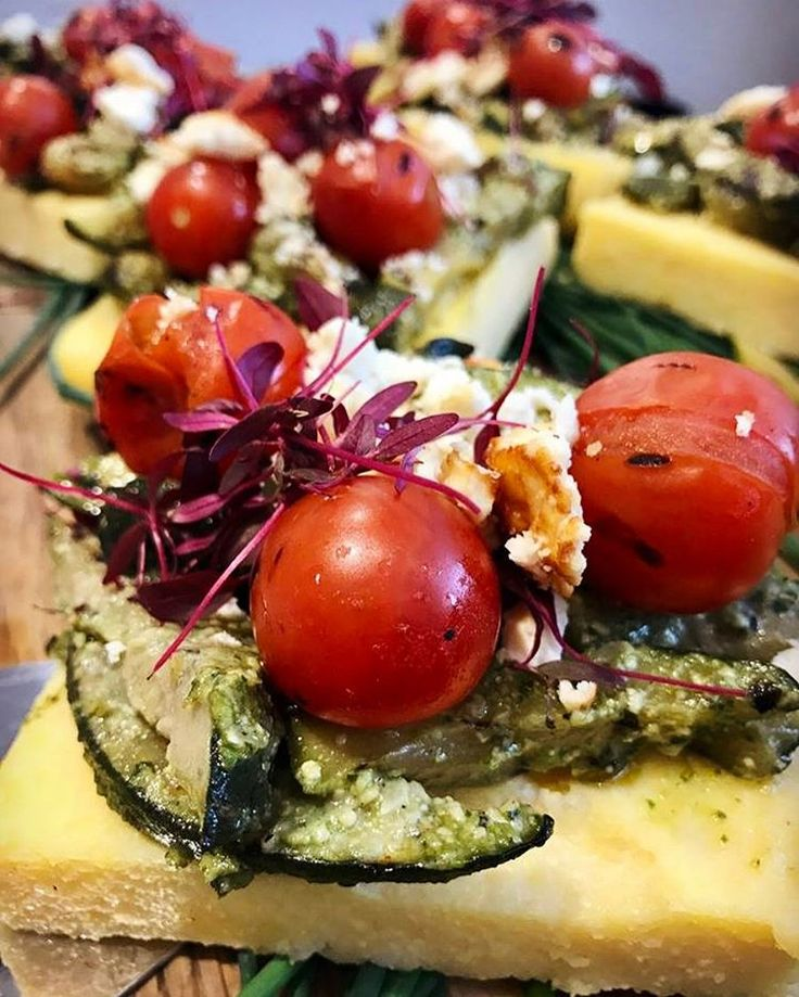 Baked polenta with courgette, pesto, feta, cherry tomato and herbs at Ottolenghi Belgravia.
