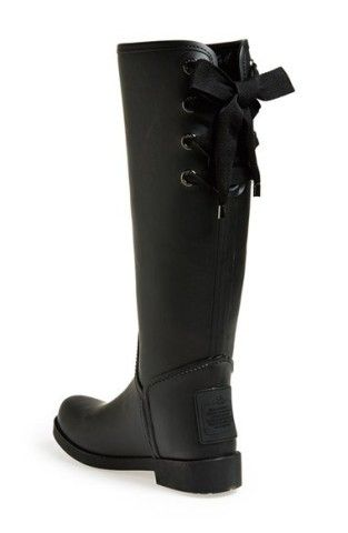 Ladylike laces cinch the shaft of a puddle-proof boot. Approx. heel height: 1.Partial lace-up closure.Approx. boot shaft height: 15 1/2; 15 calf circumference.Synthetic upper/textile and synthetic lining/rubber sole.By COACH; imported.Women's Shoes.Have Questions? Call 1.888.282.6060.