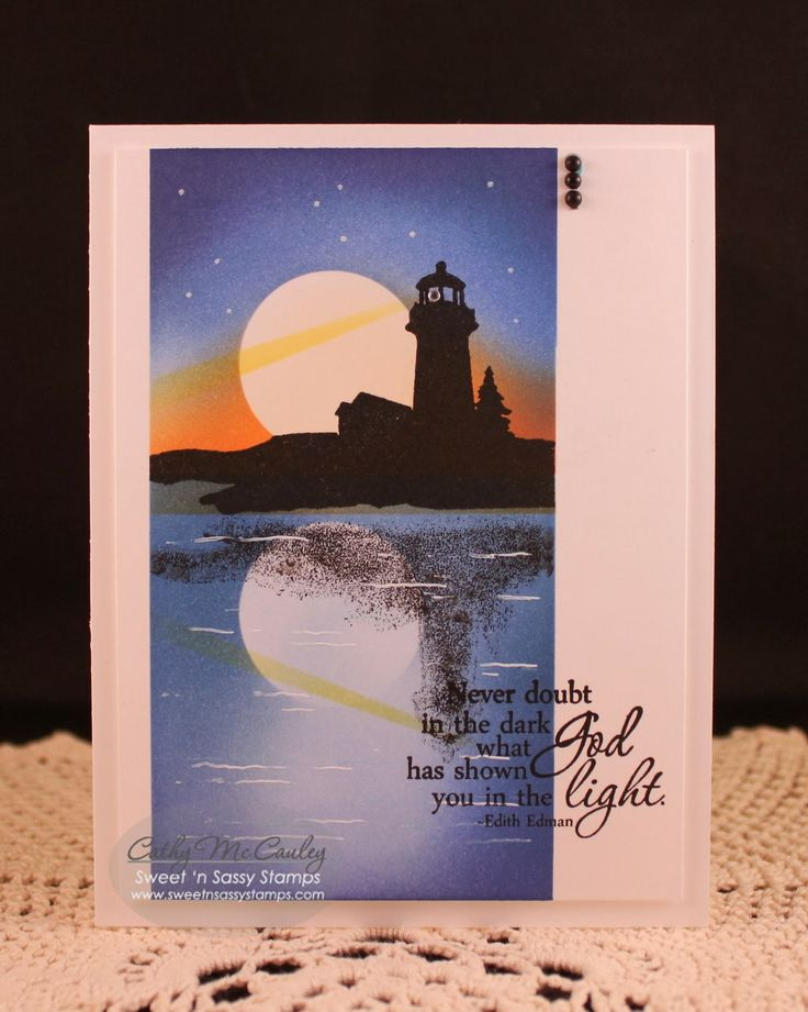 """By Cathy McCauley. Mask section of card front with Post-It notes. Sponge background. Stamp lighthouse from """"Landscape Silhouettes"""" Versafine Onyx Black ink. Stamp image again onto a stamp positioner imaging sheet (or acetate), and press, ink side down, under the lighthouse to create the reflection. Stamp sentiment partly in the dark and partly in the light areas of the front panel. Use white gel pen to add stars and waves."""