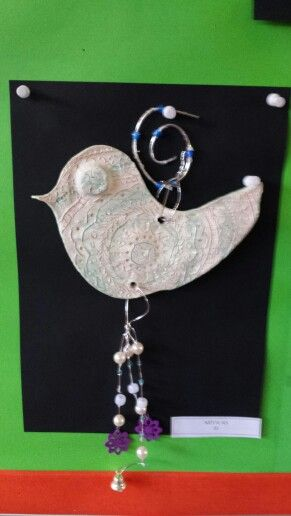 Clay wire hanging birds by grade six.
