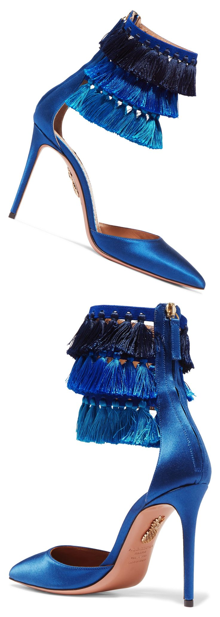 To mark her 30th anniversary in the fashion industry, iconic supermodel Claudia Schiffer has created shoes with Aquazzura that mirrors her own personal style. Named after London's nightclub Loulou's, these pumps are made from smooth royal-blue satin and decorated with tiers of tassels at the ankle show them off with midi length skirts. #eveningshoes #christmaspresents #giftsforher #tassels #tasselshoes #underthetree #shoeaddict #valentinesgifts #affiliatelink #shoes #fashion #fashionblogger