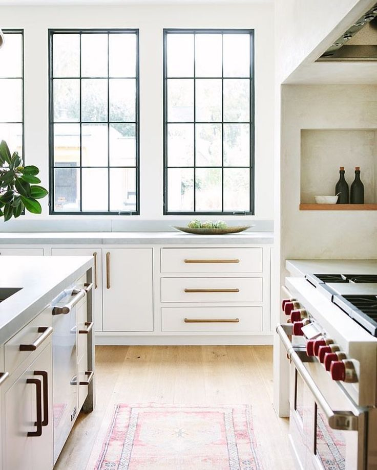 White Kitchen With Black Windows And Light Floors