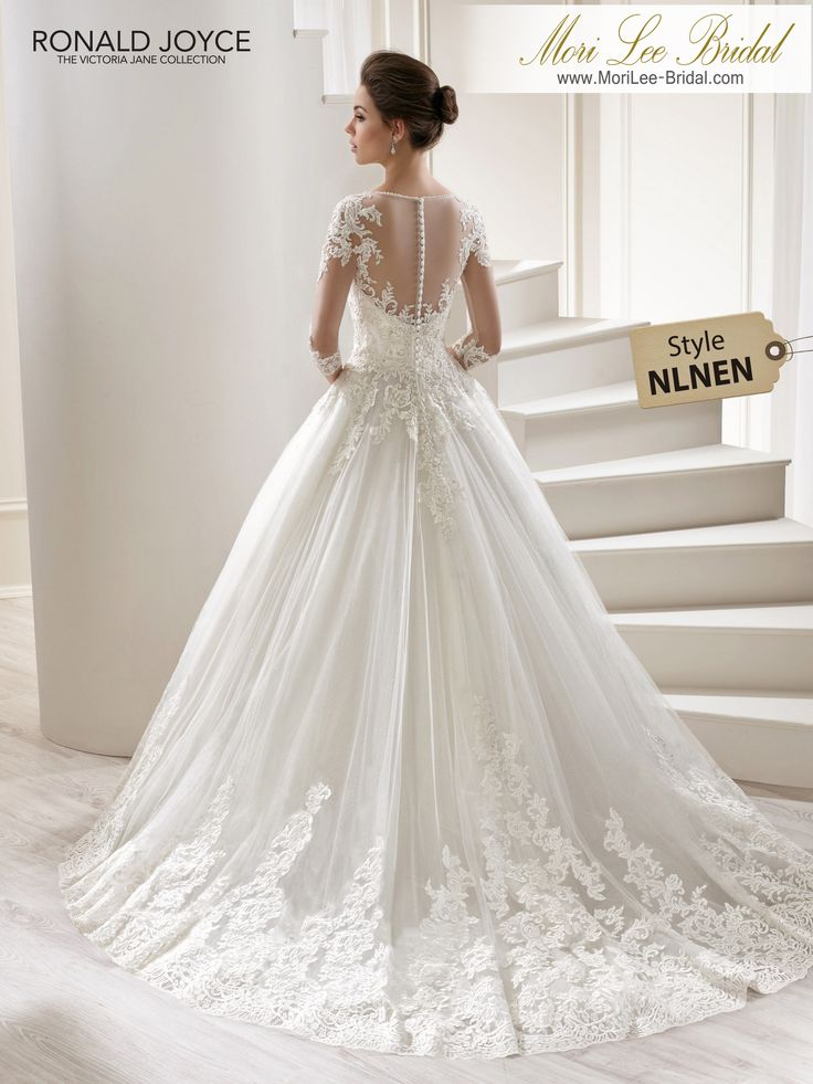 Style NLNEN LILITHA 3/4 LENGTH SLEEVED TULLE AND SPARKLE TULLE BALL GOWN WITH LACE MOTIFS AND ILLUSION NECK/BACK. PICTURED IN IVORY.AVAILABLE IN 3 LENGTHS: 55', 58' AND 61' COLOURSWHITE, IVORY