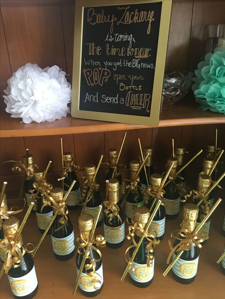 "Ready to Pop baby shower with mini champagne bottle favors! Customized mini champagne bottles with mint and gold colors and ""she's about to pop"" labels from etsy."