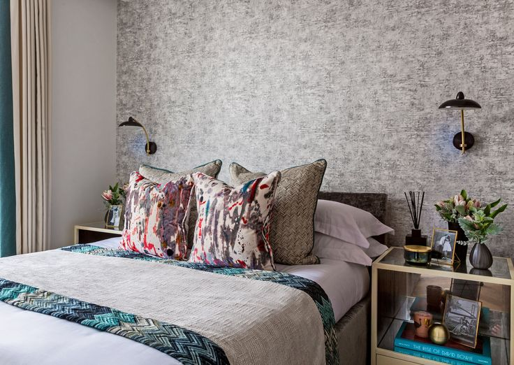 Layers of varying textures, patterns and colours add depth and vivacity to the bedroom design of our trendy East London apartment project, with stunning print cushions by Zinc Textile.