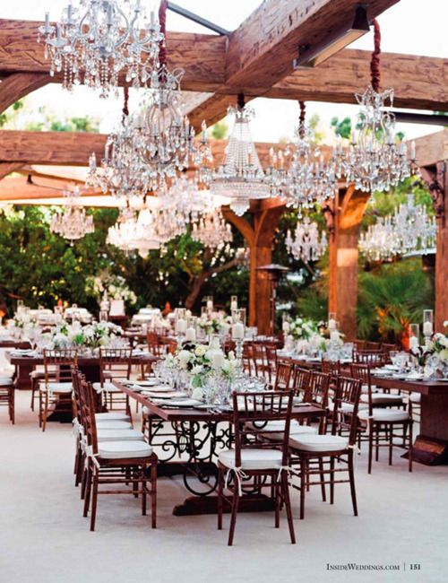 Outdoor dining with chandeliers