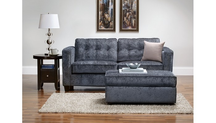 This sort of has a mid-century feel to it. The fabric may just not photograph well. Plus, it's a sleeper if someone stays over. Pair with a different chair or love seat for eclectic look.