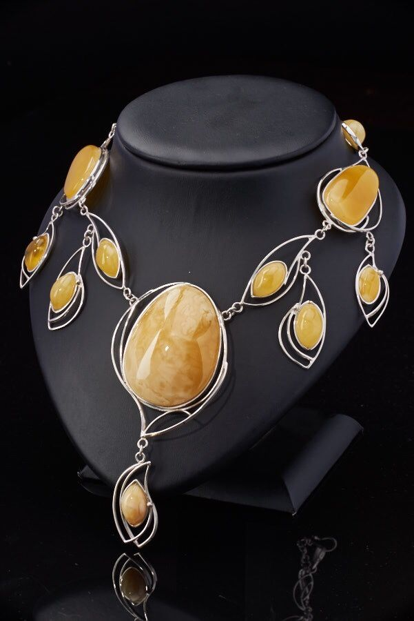 Beautiful honey color amber in silver necklace