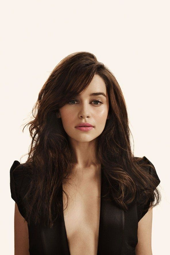 Emilia Clarke in an open black dress with deep v-neck to the waist, a modern classic beauty, star of Game of Thrones, Terminator Genisys, and Me Before You. #EmiliaClarke #blonde #blondes #brunette #brunettes #portrait #portraits