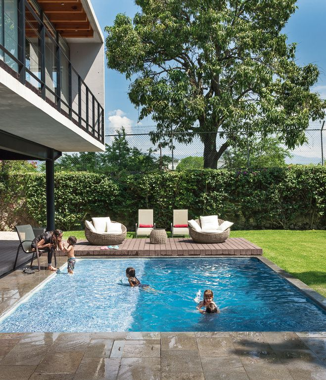 The house is oriented toward the expansive backyard, where the family spends 80 percent of its time. Alfredo's wife Lorena, son Lorenzo, ...