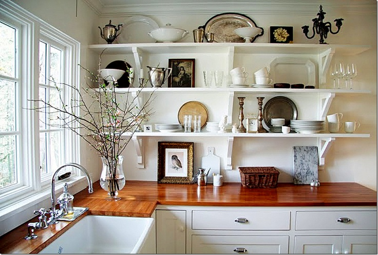Timber benchtops are making a comeback.  This is a beautiful combination with the open shelving and farmhouse sink.