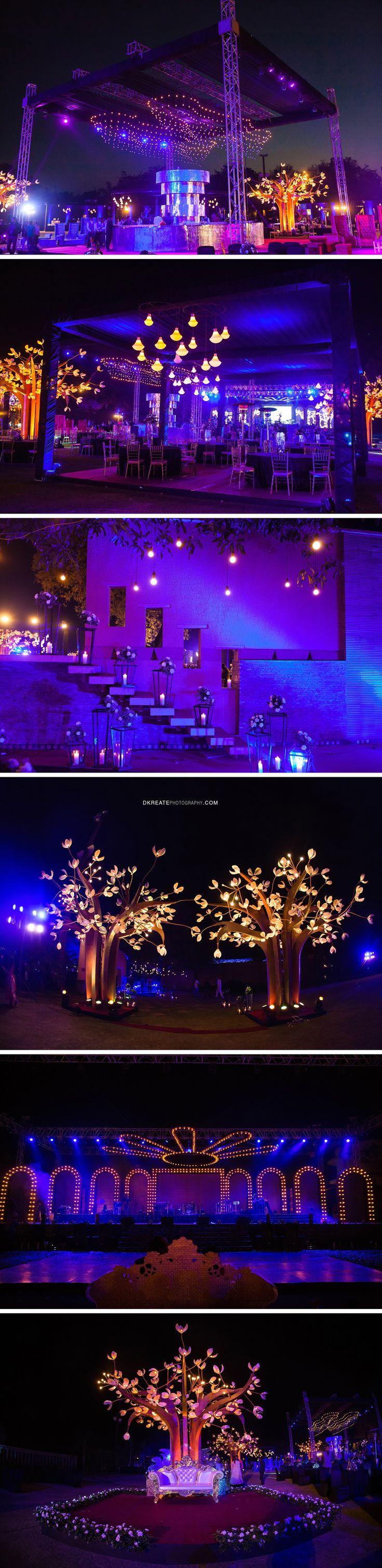 Indian Wedding Decor Inspiration | Grand Cocktail Sangeet Decor. Light tree. Big performance stage. Stage for the brie and groom. Fresh flower, lanterns, Candles, Bar decor inspiration. Big Fat Indian Wedding Purple Pink Gold White #wedmegood #maharaniwedding #Bigfatsouthasainwedding