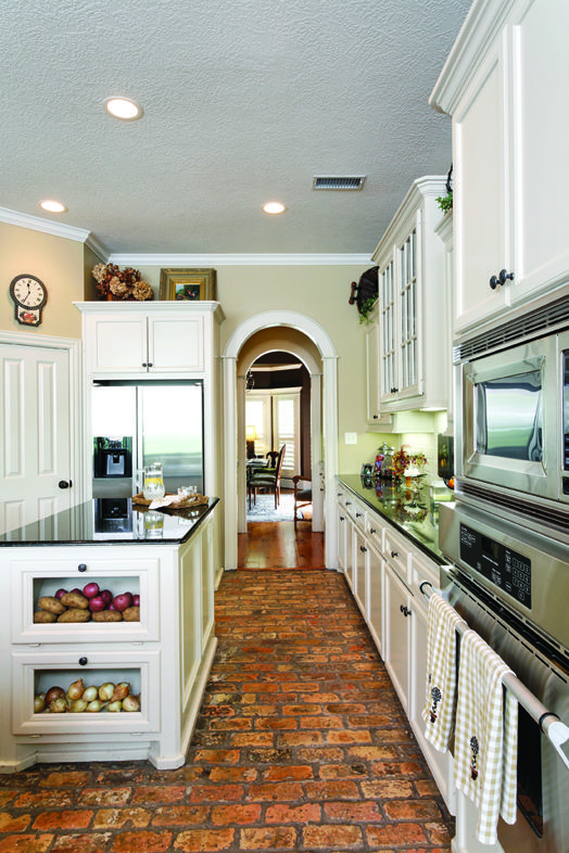 Old Brick Floors And Gleaming Granite Countertops Make For A New  Orleans Style Kitchen.