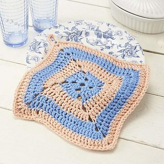 Slightly skewing a standard square adds a fun twist to this delightful crocheted pot holder.