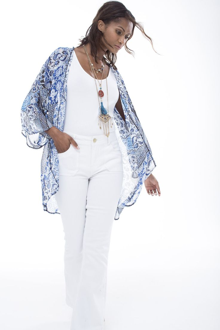 The boho printed kimono a summer essential, especially when paired with all white vest and denims. #miladys #whiteonwhite #denim #kimono