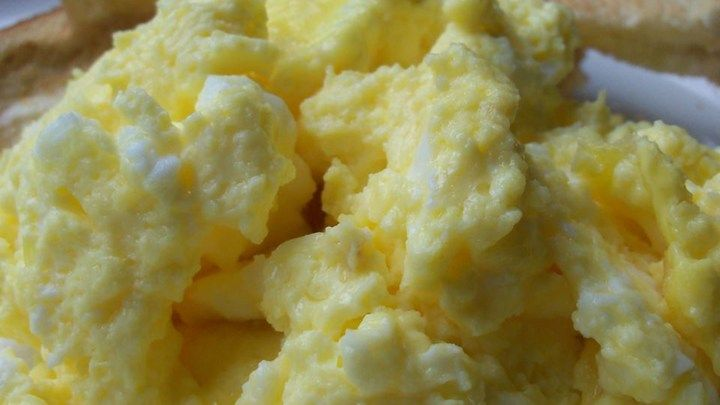 These light and fluffy scrambled eggs  are a snap to put together for a big crowd. I usually make 2 pans for our Christmas Brunch, and I never have much left over!